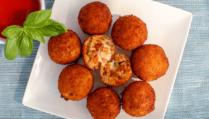 Enjoy our recipe for arancini di riso alla Bolognese.